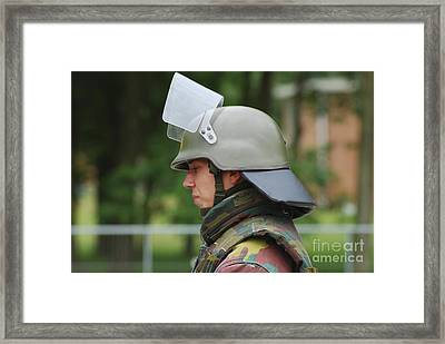 The Helmet And Visor Used Framed Print by Luc De Jaeger