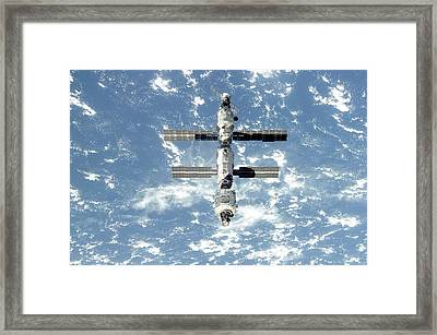 The International Space Station Is Seen Framed Print by Everett