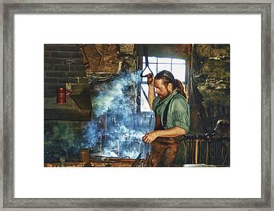 The Iron Man- Blacksmith Framed Print