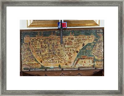 The Lid Of A Chest Bears A Map Framed Print