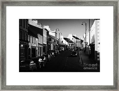 the main through road in Ballycastle Ann Street county antrim northern ireland Framed Print by Joe Fox