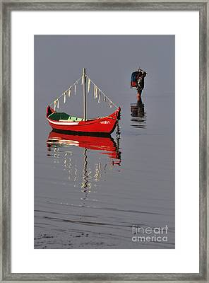 The Man And The Boat Framed Print by Armando Carlos Ferreira Palhau