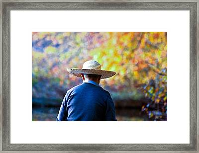 The Man In The Straw Hat Framed Print by Ann Murphy