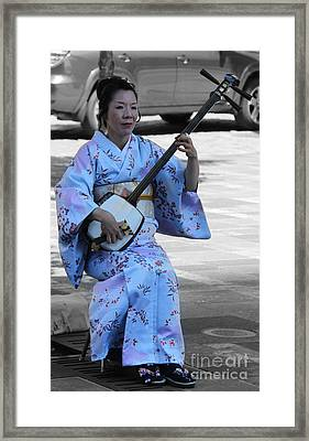 The Mandolin Player Framed Print by Lee Dos Santos