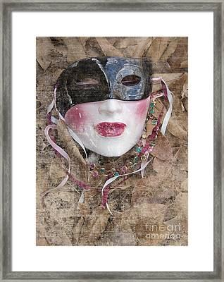 The Mask In The Leaves Framed Print by Carolyn Fox