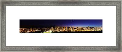 The Moon And Venus Over Honolulu Framed Print