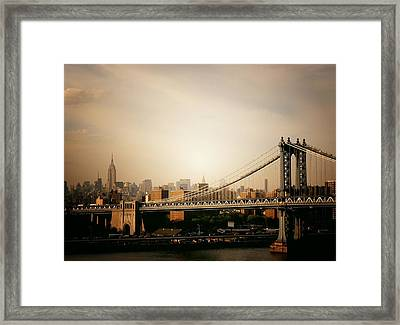 The New York City Skyline And Manhattan Bridge At Sunset Framed Print by Vivienne Gucwa
