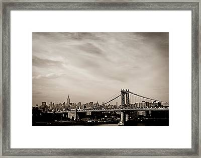 The New York City Skyline And The Manhattan Bridge Framed Print by Vivienne Gucwa