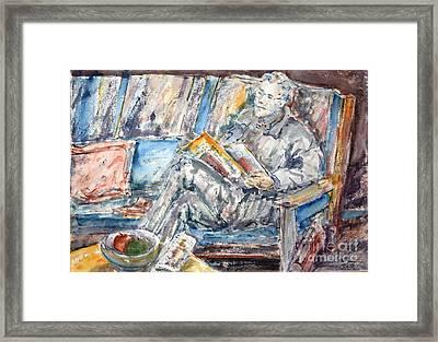 The News Reader Framed Print by Phong Trinh
