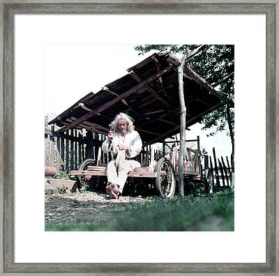The Old Man Working On The Wooden Car Framed Print by Emanuel Tanjala