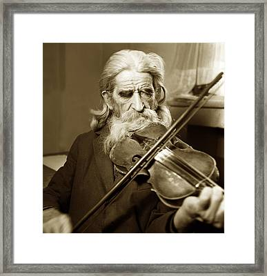 The Old Violonist Framed Print