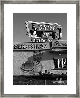 The Penguin Drive-in Framed Print by David Bearden