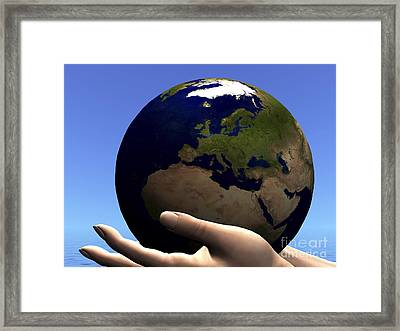 The Planet Earth Is Held In Caring Framed Print by Corey Ford
