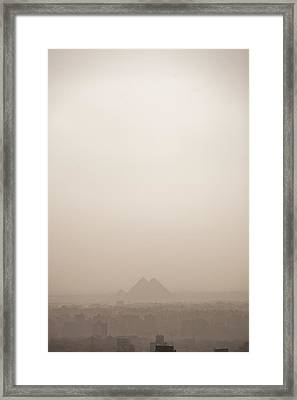 The Pyramids Rise Over The Smog Framed Print by Taylor S. Kennedy