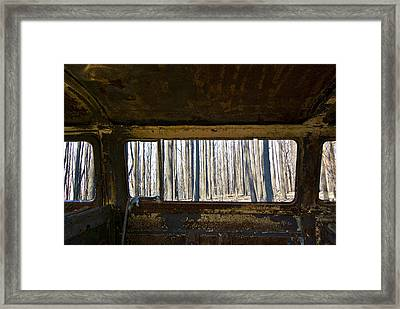 The Shell Of A Burnt Out Car Rests Framed Print