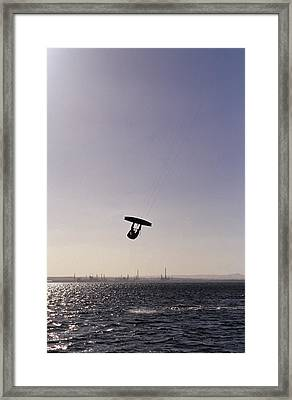 The Silhouette Of A Person Kite Framed Print by Jason Edwards