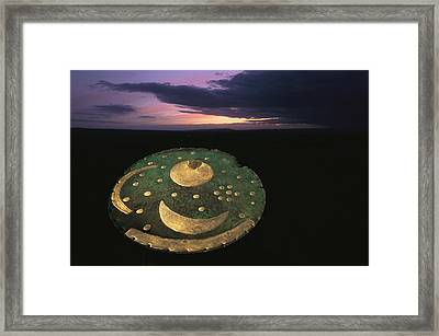 The Sky Disk Against A Framed Print by Kenneth Garrett