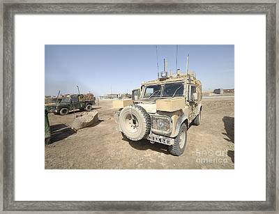 The Snatch Land Rover Patrol Vehicle Framed Print by Andrew Chittock