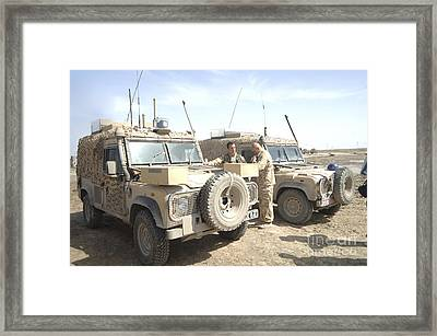 The Snatch Land Rover Used Framed Print by Andrew Chittock