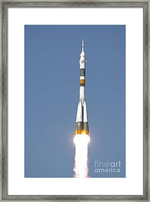 The Soyuz Tma-12 Spacecraft Lifts Framed Print