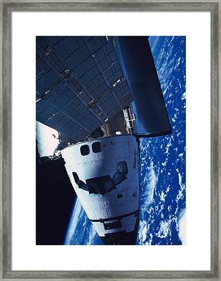 The Space Shuttle Docked With A Space Station Framed Print