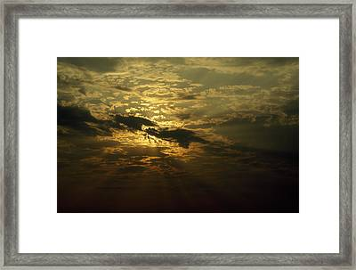 The Sun Obscured By A Late Afternoon Framed Print by Jason Edwards