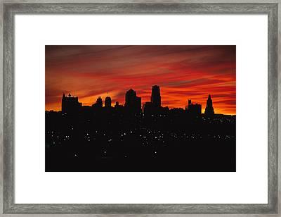 The Sun Rises Over The Skyline Framed Print by Stephen Alvarez