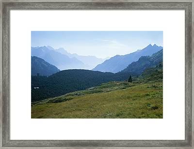 The Swiss Alps Recede Into The Distance Framed Print by Taylor S. Kennedy