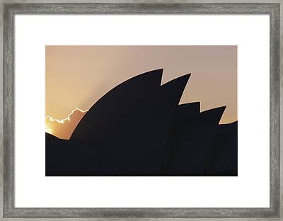 The Sydney Opera House Is Silhouetted Framed Print by Robert Madden