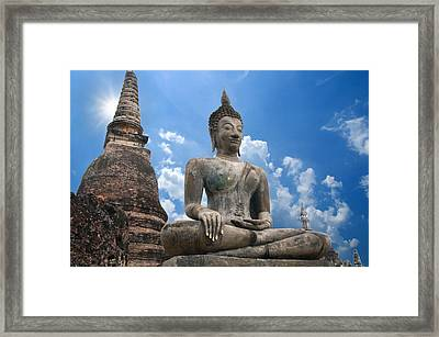The Tian Tan Buddha In A Dramatic Sky Background Framed Print
