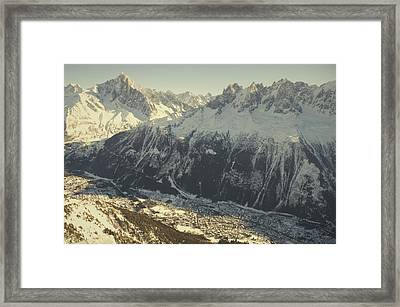 The Tourist Resort Of Chamonix Sits Framed Print by Nicole Duplaix