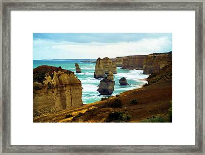 Framed Print featuring the photograph The Twelve Apostles - Lost Apostle by Dennis Lundell