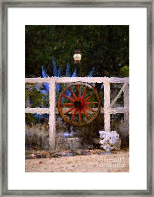 The Wheel On The Fence Framed Print by Donna Greene