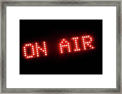 The Words 'on Air' In Illuminated Light Bulbs Framed Print by Caspar Benson