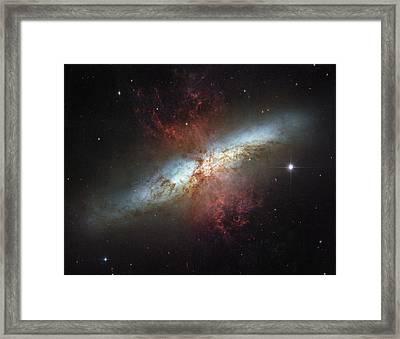 This Galaxy Is Called The Cigar Galaxy Framed Print by ESA and nASA