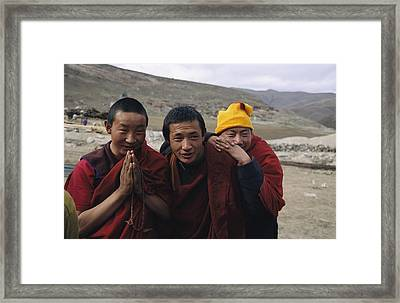 Three Buddhist Lamas In Gansu Province Framed Print