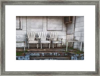 Three Chairs Beyond Front Street Framed Print