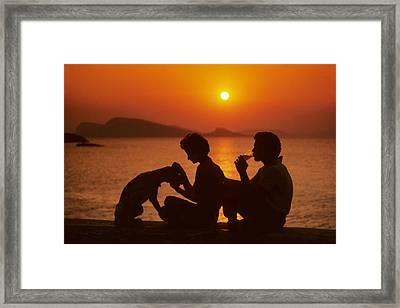 Three Friends On Mykonos Framed Print by Carl Purcell