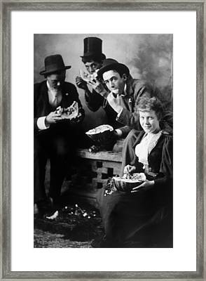 Three Men And A Woman Eating Framed Print by Everett