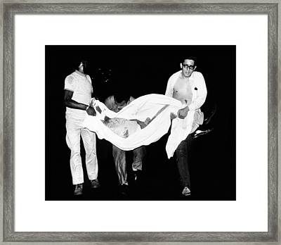 Three Men Carry Body Of A Youth Who Framed Print by Everett