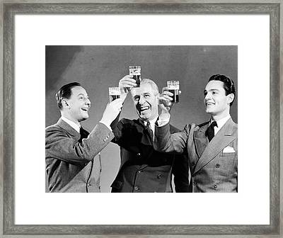 Three Men Making Toast With Glasses Of Beer (b&w) Framed Print by Hulton Archive