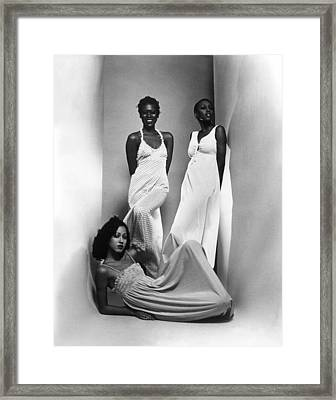 Three Models Sport Maxi-dresses Framed Print by Everett