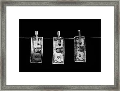 Three One Dollar Bill Banknotes Hanging On A Washing Line With Blue Sky Framed Print by Joe Fox