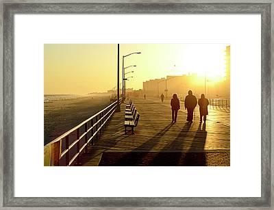 Three People Walking Down Boardwalk Framed Print