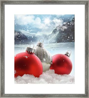 Three Red Christmas Balls In The Snow Framed Print by Sandra Cunningham