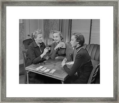 Three Women Playing Cards In Living Room Framed Print by George Marks