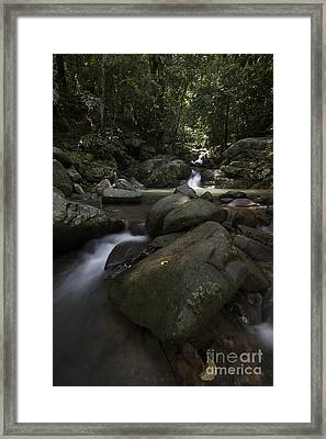 Framed Print featuring the pyrography Through The Rocks. by Gary Bridger