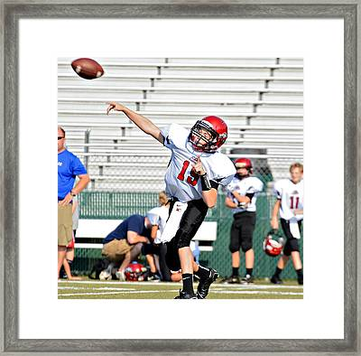 Throwing A Pass Framed Print by Susan Leggett