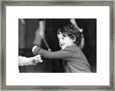 Throwing A Punch Framed Print by Graham Wood