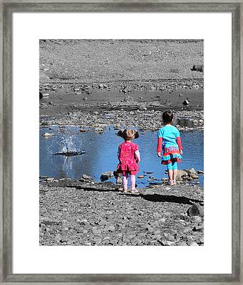 Throwing Stones Framed Print by Paul Ward